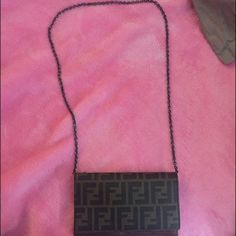 Authentic fendi handbag for women Fendi handbag with compartments inside .. Has been worn a few times slight stitching out of place on the inside no holes no damages FENDI Bags