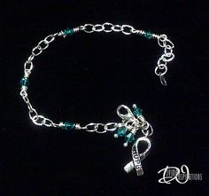 Ovarian Cancer Awareness Bracelet accenting with stunning teal swarovski crystals throughout the bracelet as well as dangling at the end with a silver awareness ribbon with 'hope' on it. Handcrafted by Divine Inspirations Jewelry  Check out my Etsy shop: https://divineinspir8ions.etsy.com Or my facebook: www.facebook.com/pages/divine-inspirations-jewelry/119517998156621