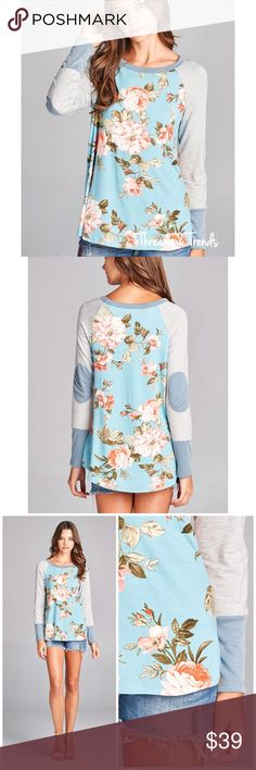 Floral Jersey Knit Top Vibrant floral print knit top with long solid raglan sleeves and color block  cuffs and elbow patches. A sporty adaptation to a floral feminine print, add some glam to your casual outfit.   96% Rayon, 4% Spandex                                                                65% Modal, 35% Polyester Threads & Trends Tops