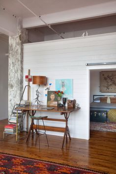 "Sneak Peek: An Eclectic Philadelphia Loft. ""We love collecting the work of local artists. Our favorites are the dog prints by Lauren Walcott and illustrations by Kris Chau. Lauren painted our Charlie for us!"" #sneakpeek"