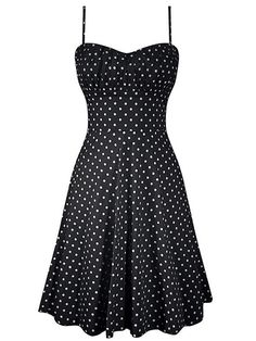 This little a-line, polka dot dress has a beautiful fit! Smocking in the back and a ruched bust makes an impeccable look. Available in black, white, and red polka dot.