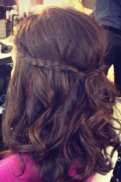 Can't French braid? Pair curly hair with two regular braids and pin them back for a great hairstyle.