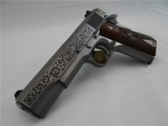 Colt 1911 Government  A limited edition, custom engraved Colt 1911. According to the seller it's #86 out of 250. 1911′s are plentiful on the market but like anything brand names will command higher prices. Engraving can add to the value depending who does the work and how well it's done. (GRH)