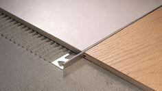 Detail in brass Floor Design, Tile Design, House Design, Tile To Wood Transition, Tile Edge, Window Fitting, Tile Trim, Floor Ceiling, House Tiles