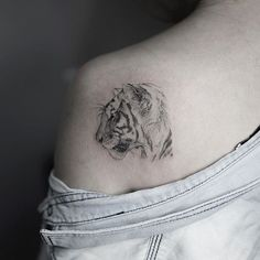 White tiger shoulder tattoo by soltattoo Korea. By Sol Art on instagram.