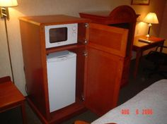 Stealing an idea from the hotel industry,...possibly for my neices dorm room - microwave and mini fridge fit in cabinet.