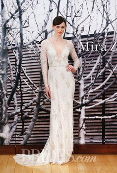 "Brides.com: Mira Zwillinger - 2014-2015. ""Lysha"" long-sleeved sheath wedding dress with a deep v-neckline and beaded details, Mira Zwillinger"