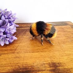 Hi all my name is heather I make needle felted animals here is a picture of my latest work a little needle felted bumble bee by feltingtreasures