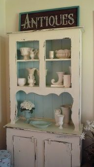 Pretty vintage hutch...love the antiques sign!