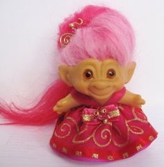 Vintage DAM Troll Doll (clearly marked on her back) with her original amber glass eyes and new watermelon pink Icelandic sheep hair. She is 2 3/4 from the bottom of her feet to the top of her brow. She is flawless. Handmade dress with a snap in the back for easy removal. Matching hairpiece. I make all of my own outfits. She lives in a non smoking home and is from my personal collection. Shipping is via usps. I combine shipping. Any other item in the same order ships for free.