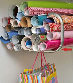 use a bike rack mounted inside the closet to store rolls of wrapping paper
