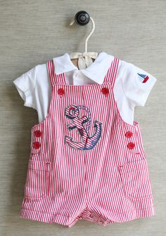 Tiny Sailor Overall Set 32.99 at shopruche.com. Your little sailor will be cute and comfortable in this darling two piece set. Featuring a soft jersey polo shirt in ivory with front button closures and an embroidered sailboat on the sleeve. Red and white striped overalls detailed with front pockets, button closures, and snap closures at the bottom complete the set. Machine washable.100% Cotton, Imported