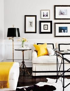 Black + white living room with pops of yellow