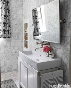 A Chatham pivot mirror by Restoration Hardware hangs above the generous Aquagrande sink by Lacava. Acqui faucet by Rohl.   - HouseBeautiful.com
