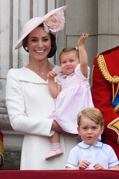 The Duchess of Cambridge, Princess Charlotte and Prince George watch a fly past during the Trooping the Colour. (Photo by Ben A. Pruchnie/Getty Images)  via @AOL_Lifestyle Read more: http://www.aol.com/article/2016/06/11/princess-charlotte-balcony-debut-kate-middleton/21393516/?a_dgi=aolshare_pinterest#fullscreen