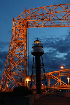 Duluth Breakwater Inner Lighthouse and Aerial Lift Bridge at night.