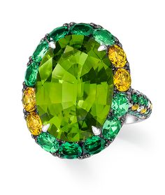Cellini Jewelers Oval Peridot and Yellow Sappire Ring. Set in 18 Karat White Gold.