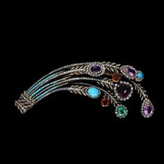 Aigrette, brilliant-cut diamonds, turquoises, an emerald and other coloured stones. French.  c1810.
