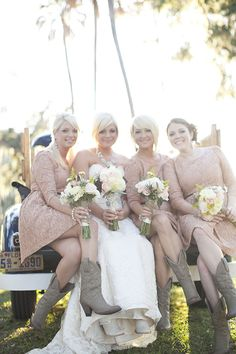 Bridesmaids in peach laces dress and cowboy boots. Way cute!