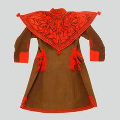 Poland - The back of a boy's sukmana coat, the so-called kierezja. Embroidered collar, the so-called suka. On the sides, mock pocket cuts (no pockets). Appliqué decorations of red wool