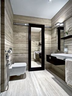 That's a very nice mirror in this modern bathroom. Sink area is pretty great as well.