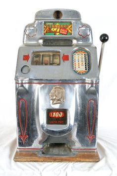 Old JENNINGS Chief slot machine. I have a nickel one just like this one that is all original, completely restored and works perfect!!!! It is beautiful....
