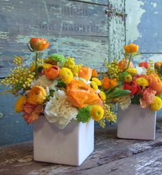 """Sunny Side  Orange, acid yellow and neon green are the colors of the season. They just might jog memories of a favorite childhood candy. """"Think Starburst fruit chews colors!"""" says Clover. Get the look by filling a fun, tall container like Jonathan Adler's Man/Woman Vase with trippy round flowers such as poppies, dahlias and craspedia pom poms in different sizes."""
