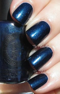 I Love Nail Polish Exodus is a dark blackened blue with an intense blue green shimmer.