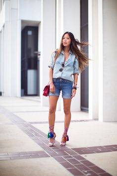 denim on denim outfit with colorful tassel sandals
