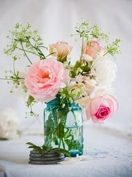 """Mason Jar Centerpiece (not blue)- simple blooms will be inexpensive, can also be less """"wild"""" than this"""