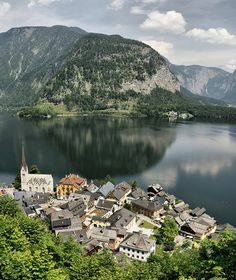 Hallstatt, Upper Austria; been there with the boys; take a ferry across the lake to the village and them take a tram up to the mountain to explore the salt mines. great salt mine slides!; and very beautiful