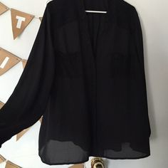 Black silky work blouse with lace accents Amazing top for work, transitions easily to a night out. Black silky material with lace pockets and lace accents around the shoulder. I wear a 16/18 normally and the top fits loosely but not too baggy on me Alfani Tops Blouses