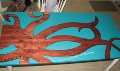 My octopus kitchen table I made. Just painted over a cheap Ikea table!