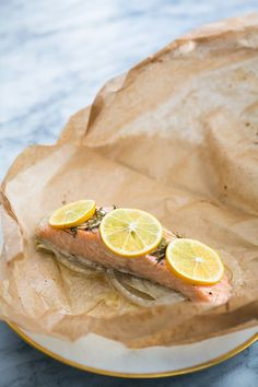 Salmon with Fennel Baked in Parchment ~ Quick and easy, salmon fillets, nestled on a bed of fennel, dotted with lemon and butter, baked in a pouch of parchment paper. ~ SimplyRecipes.com