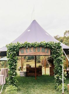 ivy garland on star Sperry tent by Ritzy Bee Events, signage by @simplesong. Photography by Clark Brewer.