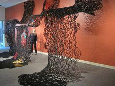 "Suzan Shutan, artist, tar paper & handmade paper, ""Watered Down"" exhibit  Norfolk Art Center, NE 2012"