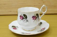 Elizabethan Fine Bone China Cup and Saucer with Red Roses This is Fine Bone China Cup and Saucer from Elizabethan with set features Red Roses. This set is in Excellent Condition with No Chips, No Cracks and No Crazing. The Gold Trim is in Good Condition. Dimensions: Tea cup, top