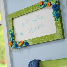 I upcycled an old wood frame into a polka spotted chalkboard.