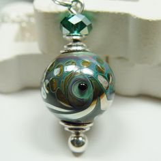 """Hand-made Glass Cremation Urn Necklace I ordered this custom piece to put my grandparents' ashes together in. They both loved the ocean and this reminds me of them. """"Breathless""""  by ClearlyLoved, $69.95"""