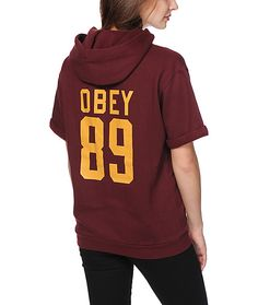 """Mix up your sweatshirt collection with this short sleeve pullover hoodie that features a script graphic at the chest and """"Obey 89"""" printed on the back."""