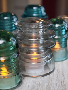 glass insulators - I put these around the garden and home. Use led tea lites