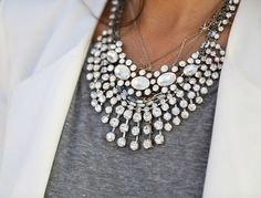 Love a white blazer, gray tee & a statement necklace.
