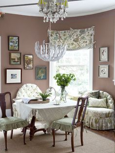 Give Shape to a Dining Room  A custom banquette, designed to mimic the dining room's rounded wall, offers comfy seating. The homeowner of this colorful home inherited the table from her great-grandmother, and the chandelier is part of Stray Dog's new collection for West Elm.