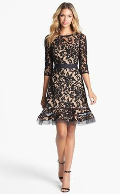 """Belted Lace Dress - Lyst ~ Tadashi Shoji Black Belted Lace Dress Narrow inlays of airy tulle create a pretty flounce at the hem of a lace dress with otherwise simple lines. A jewel neckline and three-quarter sleeves nicely balance the sheer fabric and grosgrain ribbon belt. 38"""" length (size 8p). Back zip closure. Slip lining. Rayon/polyester; dry clean. Special occasion."""