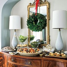 86 Fresh Christmas Decorating Ideas | Decorate with Family Heirlooms | SouthernLiving.com I love buffet tables because I think it is easier for the guests and it looks quite lovely.