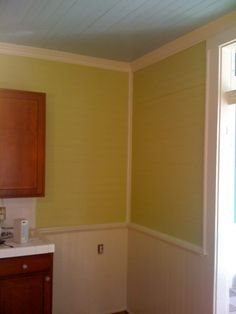 Kitchen with a limey-green Valspar color wall and Antique White trim and cherry cabinets