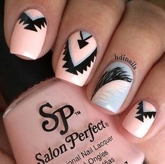 A glamorous pink theme feathers nail art design. Cover your nails in pink grey polish adding black and grey feather and tribal designs. It looks pretty and gorgeous at the same time.
