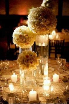 flowers on vases & add fish in the vases- for an under the sea wedding. put shells around the vases & candles & ta-da center pieces!