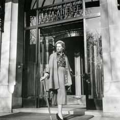 Christian Dior model in front of the Plaza Athénée Paris in 1955
