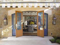 The purple doors reflect the copper, #Italianate lanterns uniquely. #Bevolo